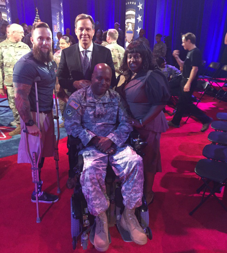 CNN Anchor Jake Tapper (center) with Brandon Rumbaugh and Dwayne and Shontel Cole at CNN's Town Hall meeting with President Obama on Sept. 29, 2016.