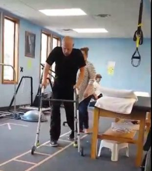 Army Sergeant Aaron Jolly takes steps again after being paralyzed