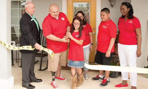"Army SGT Juan ""Carlos"" Vasquez cut the ribbon for his accessible home provided by Homes For Our Troops"
