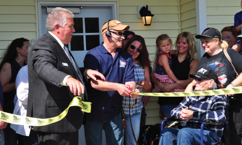 Army MSG Eric Marts cut the ribbon for his accessible home provided by Homes For Our Troops